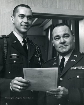 Cadet Col. Minney (left), and Col. Edwin Reynolds (right).
