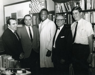Left to right, Robert E. Lanham, Assistant Professor; Joe Clark Theiss, Teaching Assistant; Unknown; Dr. Royal C. Gilkey, Professor; John Barnes, Graduate Assistant.