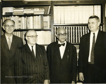 Left to Right, Armand Singer, French; Warren F. Manning, French; Unknown; Robert Stilwell, Head of Department of Foreign Languages, Spanish, German.