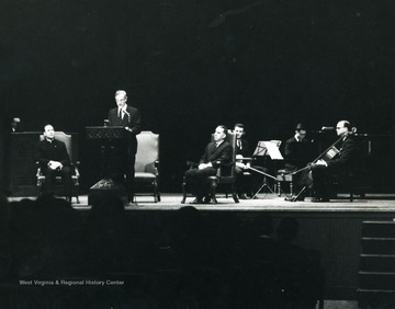 On Stage: Dr. Irvin Stewart, Speaking; Joseph Gluck, Seated at right; American Arts Trio - Portnoy, Drucker, Engberg.