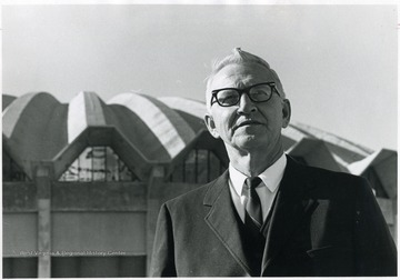 Dean Yost standing in front of the West Virginia University Coliseum.