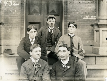 Fred Davis (back row, center), Harry Cole (first row, right), and three unidentified students.