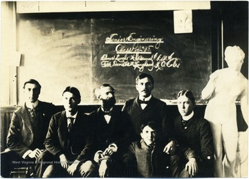 Senior Engineering students posed in classroom.  From left to right:  Harry Cole, Bert Lawhead, Elmer Leach, Bill Bruner, Fred Davis, and Charles McCoy.