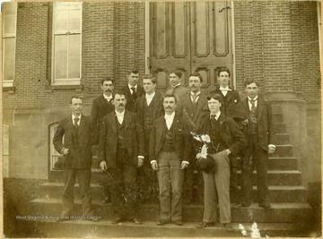 Dr. Hartigan, the instructor, is in the front row, second from the left; and Wayne Willey is in the front row, on the extreme right.  The other students are not identified.