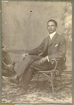 Portrait of Henrie Van Leester from Suriname, Dutch Giana. Back of photo says, 'Mr. McDonald, This is my boy whom you may expect soon. Henrie Van Leester. S. A. Esterbrook.'