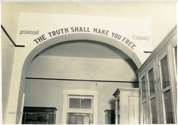 Above the entrance is written, 'The truth shall make you free. St. John, Ch. 8, Vs. 32; Jesus.'