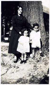 'Mrs. F. Chas. Carter and two children; 314 West Terrace Street, Syracuse, N. Y.  Chas. graduated in 1916.'  Mr. Chas. Carter was a student at Storer College for African-Americans.