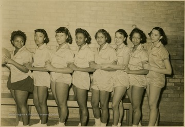 Group portrait of girls' basketball team members at African-American school, Storer College. They had 3 wins and 5 loses.