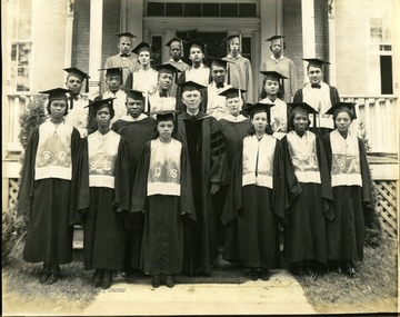 Class of 1938: 'Back row: Bruce Daniels, Hazel Brown, Mary Napper, Levi Allison, Vivian Rideoutt, Violet Green. Middle row: Cornelius Dawson, Harry J. McDonald, James Law, Herman Lytle, Pearl Abbott, Allen Anderson. Bottom row: Marion McClung, Margaret Wright, Prof. Saunder, Imogene Holley, Dr. McDonald, Dean McDonald, Mrs. Norma Moore, Charlotte Smith, Lillian Burns.