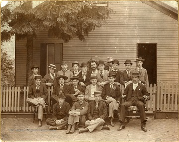 'Main Street. W. B. Cutright, Class of 1895, Commissary. Back Row (left to right): Lew Grenolds, Class of 1895. Beverly, W. Va.; J.W. McClung, ex? Ronceverte, W. Va.; E.F. Allen, ex? Montgomery, W. Va.; Jake Linn, ex? Uniontown, Pa.; G.H. Brownfield, ex? Fairmont, W. Va.; W.E. Baker, Class of 1896. Beverly, W. Va.; T.S. Tompkins, ex? Charleston, W. Va.; Charles Jacobs, ex? Charleston, W. Va.; W.T. Patton, ex? Charleston, W. Va.; Davidson, ex? Charleston, W. Va.; T.F. Watson, ex? Mobile, Ala. Middle Row (left to right): O.L. Haught, ex? Silver Hill, W. Va.; A.B. Carmack, ex? Brownsville, Pa.; C.W. Cramer, Class of 1897. Piedmont, W. Va.; J. Floyd Strader, Class of 1895. Beverly, W. Va.;  A.E. Boyd, ex? Uniontown, Pa.; W.B. Cutright, Class of 1895. Buckhannon, W. Va. Front Row (left to right): J. Morgan Orr, Class of 1892 and 1897. Kingwood, W.  Va.; L.N. Reichard, ex? Brownsville, Pa.; C.S. Elliott, Class of 1898. Redstone, Pa. This picture is from the collection of William Cramer.'