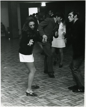 The woman in the white shirt is Playboy Magazine Playmate of the Month, Michelle Hamilton, Miss March 1968 in the ballroom of the new Mountainlair.  She was there in connection with a contest selecting a campus playmate.