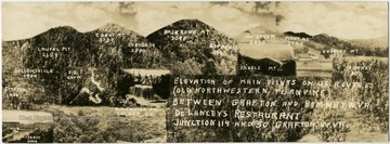 Mountains on U.S. 50, also known as Old Northwestern Turn Pike. The postcard has an advertisement for DeLancey's Restaurant in Grafton.
