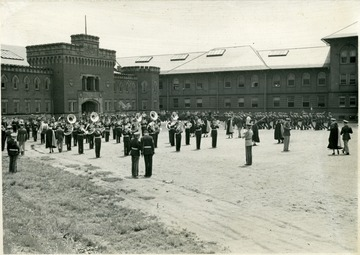ROTC Band playing as companies march on the old athletic field.