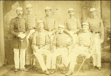 Major James M. Lee commandant on far right poses with his cadets officers. Standing next to the Major is Robert Hall Armstrong, Adjutant.