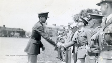 Cadet shaking hands with officials.