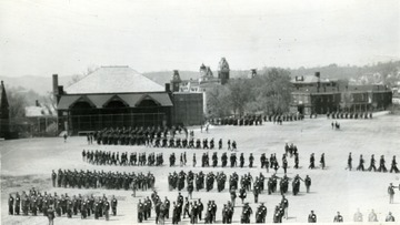 Cadets march in Drill Field, in the background Commencement Hall and the Agricultural Experiment Station.