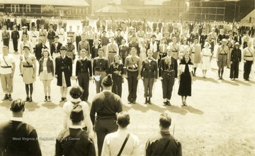Cadets and sponsors assemble in Drill Field on Old Clothes Day; many dressed for an occasion.