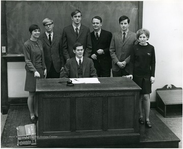 'Seated, John Nutter. From left to right: Sandra Buckley, Greg Evers, John Hoblitzell, George Blizzard, Al Martine, Linda Stenger.'