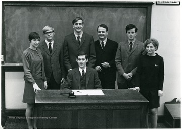 'Seated, John Nutter. Left to right: Sandy Buckley, Greg Evers, John Hoblitzell, George Blizzard, Al Martine, Linda Stenger.'
