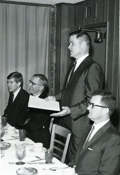 David Hardesty, then student body president sits with (from left to right) David Hess, Paul Selby, Law School Dean, and Jim Watkins at dinner.