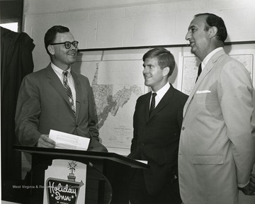 'Planning committee chairman Robert Dyck (left) chats with speakers David Hardesty (center) and Julius Singleton (right) at the June 28-29, 1967 'Man and His Community' symposium.'