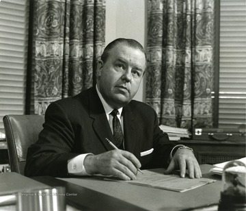 President Harlow at his desk.