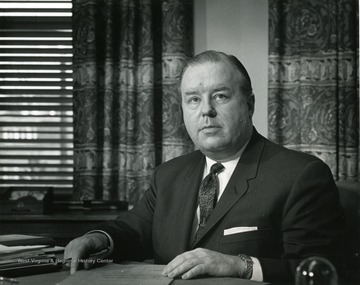 President James Harlow at his desk.