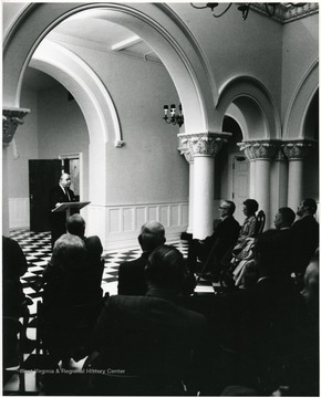 James Harlow, president of W.V.U. from 1968 to 1978, speaks to Dr. Irvin Stewart at the dedication of Stewart Hall. Dr. Stewart is seated on the right.