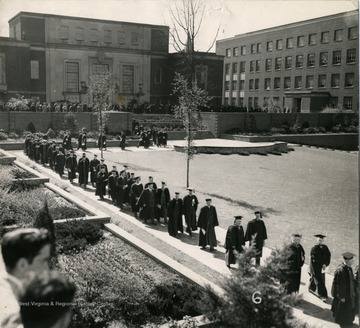 The procession as it moved passed the Chemistry building (Clark Hall) with the Wise Library and Mineral Industry (White Hall)in the background.
