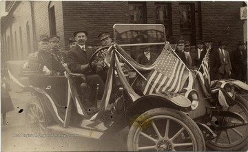 G. C. Baker, Otto Sigwart, Gen. Elliot, National Guard, Russell Huston, and Major Butts in a car for the Inauguration of West Virginia University President Thomas Edward Hodges.