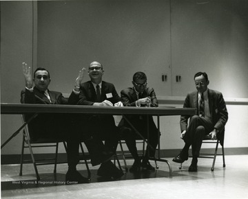'Professor of physics-at-large and legendary 'Father of the H-Bomb' Edward Teller (left) is shown speaking at a panel discussion of the Science-Writing Symposium, Oct. 6, 1967.  Also shown are panelists Harvey Rexroad, WVU prof. of physics (second from left), and George Diab, vice-president of WTRF-TV in Wheeling (second from right) and moderator John Troan, editor of the Pittsburgh Press (right).