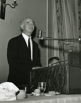 'Two-time winner of the Nobel Peace Prize, Linus Pauling, is shown speaking at the Oct. 6, 1967 Science-Writing symposium.  Vincent Traynelis, WVU prof. and chairman of chemistry and moderator of the session, is shown at the right.'