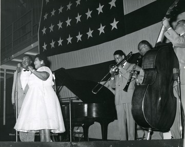 Louis Armstrong and a band; from left to right 'Satchmo' Armstrong, Velma Middleton, Trummy Young, two unidentified band members.  Others appearing were Billy Kyle, Danny Barcelone, and Edmond Hall.