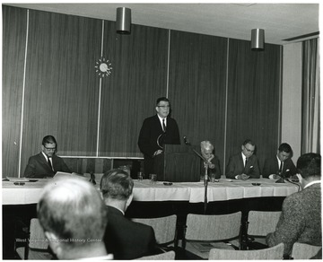 'Dean of the WVU Graduate School John Ludlum (second from left) is shown introducing main speaker W. Gordon Whaley, Dean of the University of Texas Graduate School (at Ludlum's left), at the Dec. 6, 1967 seminar on the Future of Graduate Education at WVU.  Panelists seated include three WVU professors: Hugh Lindsay, Professor of Physiology (left); Homer Patrick, Professor and Chairman of Agricultural Biochemistry (second from right); and Chin-Yung Wen, Professor of Chemical Engineering.