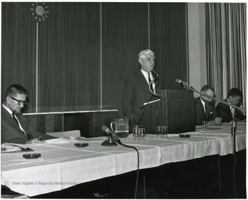 'Dr. W. Gordon Whaley, University of Texas Graduate School is shown speaking at the Dec. 6, 1967 seminar on the Future of Graduate Education at WVU.  Panelists are: Hugh Lindsay, Prof. of Physiology (left): Homer Patrick, Prof. and Chairman of Agricultural Biochemistry (second from right); and Chin-Yung Wen, Prof. of Chemical Engineering (right).'