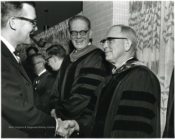 'A scene from the Mar. 7, 1967 Faculty Honors Convocation shows, from left to right; Robert Munn, WVU Prof. and Chairman of Library Science and Acting Provost; Ruel Foster, WVU Prof. and Chairman of English; Irvin Stewart, WVU Prof. of Political Science; Edmund Flink, WVU Prof. and Chairman of Medicine; George McLaren, WVU Prof. of Agricultural Biochemistry and Nutrition; and Clark Sleeth, Dean of the WVU School of Medicine.'