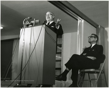 'Harvard University historian Oscar Handlin speaks at Feb. 23, 1967 lecture as part of the Lessons of History symposium, as planning committee chairman John Caruso listens in the background.'