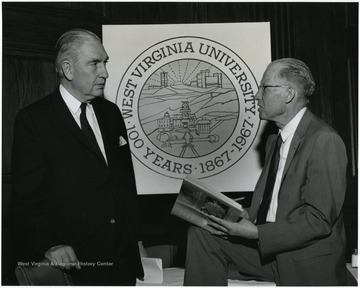 'Dr. William C. Steere, director of New York's Botanical Garden, and speaker at the May 11, 1967 Author's Banquet, chats with Dr. Earl Core, one of WVU's honored authors.'