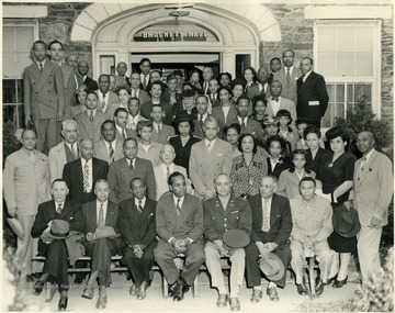 The only identified member is Richard McKinney seated, fourth from left in front row.
