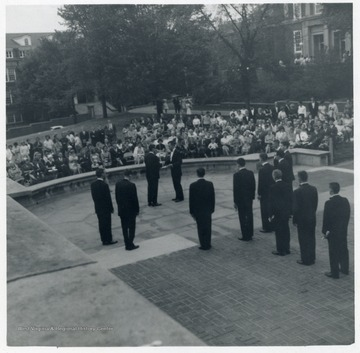 An initiation ceremony is carried out for Helvitia Society on a plaza in front of Library.