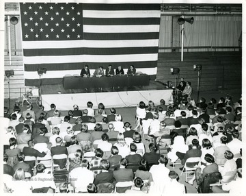 A scene from the Festival of Ideas Program showing the panelist from left to right: Wesley Bagby (History Prof.); Robert Theobald (Author); Paul Selby( Law School Dean); Arch A. Moore, Jr. (congressman); and an unidentified man, possibly State Department Official.
