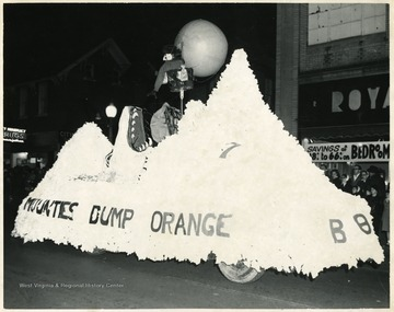A float made for Homecoming parade with an reference for an upcoming Football match with University of Syracuse 'Orange Men'.