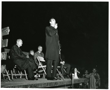 Julius Singleton (4th from left) speaks, on the stage with him (from left to right) Dave Jacobs; Tommy Miller; President Miller and Singleton.