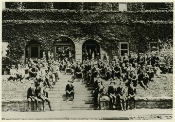 Students gather in front of the Commencement Hall.