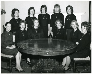 Last row, center is Jennifer Brand. Seated, from right, Carolyn Jacobs and Martha Harris.