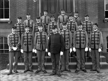 Cadet officers pose in front of Woodburn Hall.