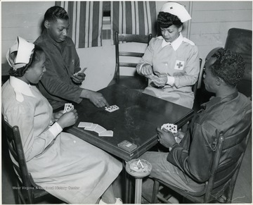 'Bridge, always a favorite game at Lockbourne Army Air Base Station Hospital, Columbus, is being played by Gray Lady Mrs. Henry T. Myrick, 256 Lexington Avenue, Columbus, Pvt. James Cumberbatch, 448 Lexington Avenue, Brooklyn, N.Y.; Mrs. Charles D. Allen, American Red Cross Franklin County Chapter Gray Lady, 84 North 17th St., and 1st Lt. Fabian O. Francis, 316 W. 12th St., New York, N.Y.'