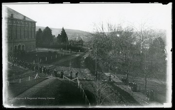 Students exit from chapel in Reynolds Hall; it is taken from the porch of Agricultural Experiment Station.