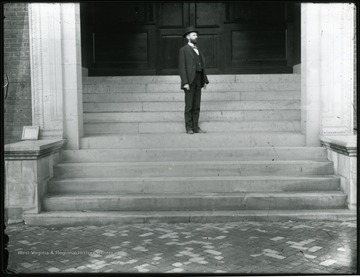 Elmer Leach stands on steps of Science or Chitwood Hall.