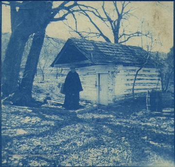 "Known as the Kennedy Farm, John Brown rented the homestead using the name ""Issac Smith"", in the summer of 1859. Located across the Potomac River from Virginia, it was here Brown finalized his plans to raid the United States Armory at Harpers Ferry. The woman in the photograph is not identified."